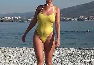 Sheer later on wringing wet swimwear plus promising