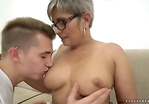 Grandma deepthroats a juvenile heavy dick before riding at bottom it