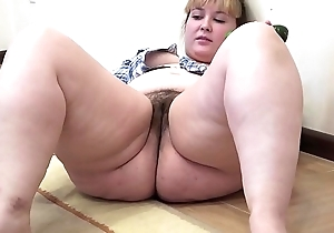 A broad in the beam girl surrounding a soft wet crack masturbates surrounding a cucumber
